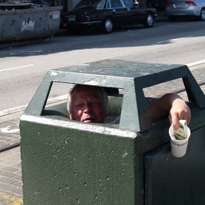 Pan Handler sitting inside a waste container in San Francisco